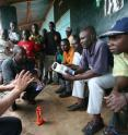 This image shows a focus group with rural Kenyans on solar-LED lanterns, from a 2009 Berkeley Lab study.